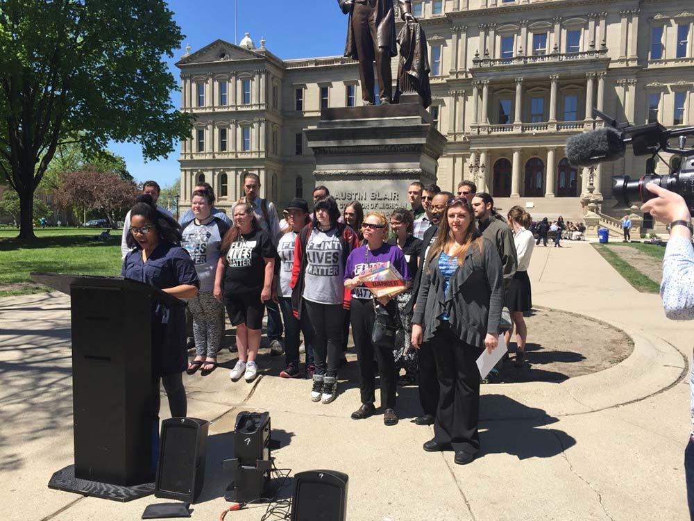 Nayyirah Shariff of Flint Rising addresses a press conference at the State Capitol on supplemental funding for Flint