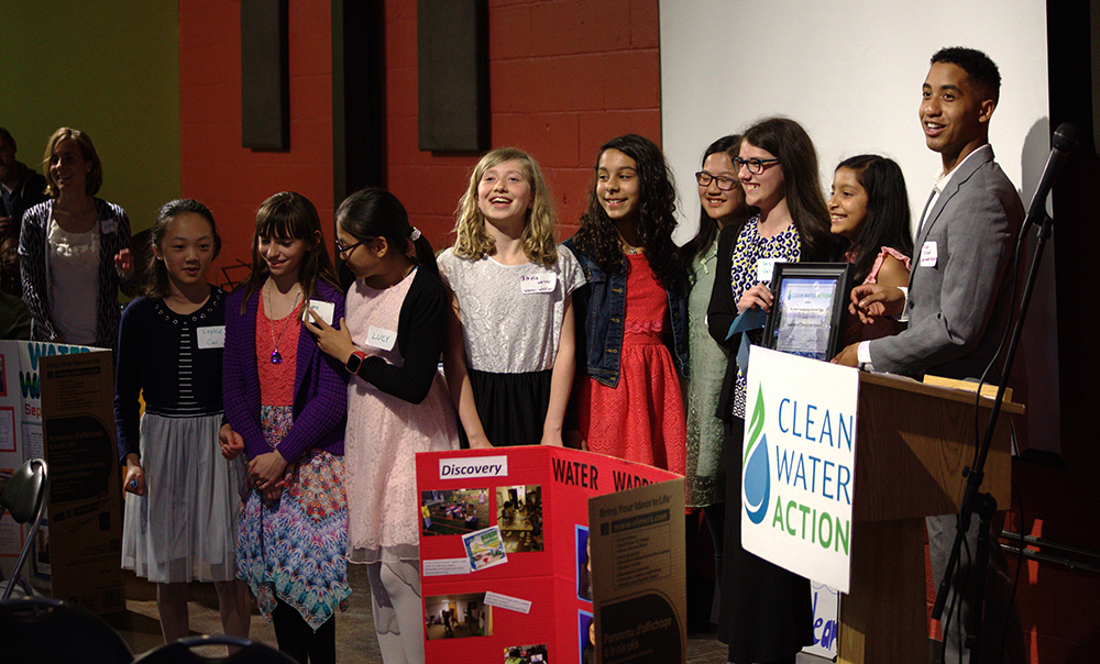 """The """"Water Warriors"""" receiving the Leaders of Tomorrow award at the 2018 GLAC"""