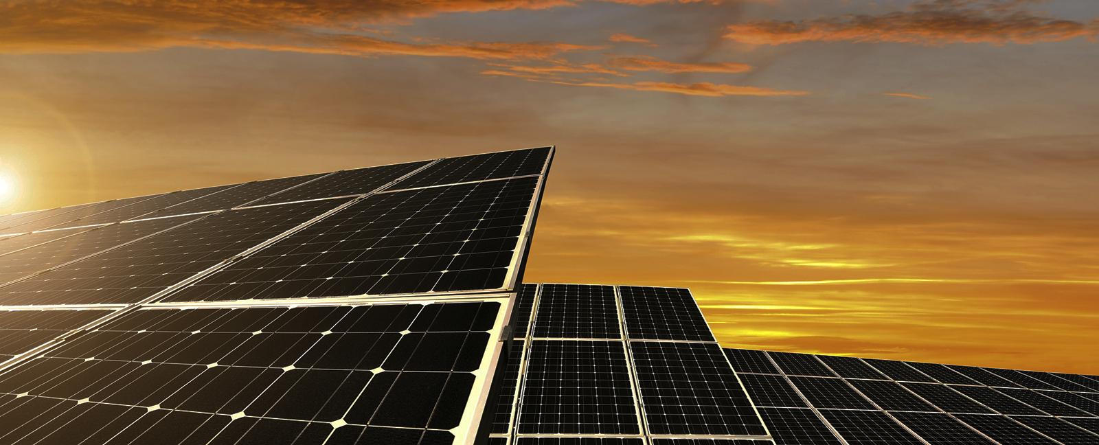 Solar panels, sunset. Photo credit: vencavolrab / iStock