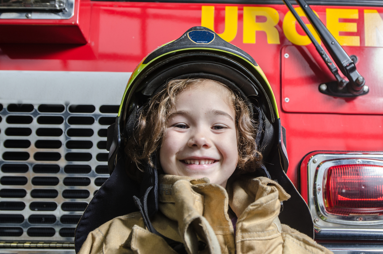 MA_istock_young-girl-wearing-fireman-coat-and-helmet.jpg