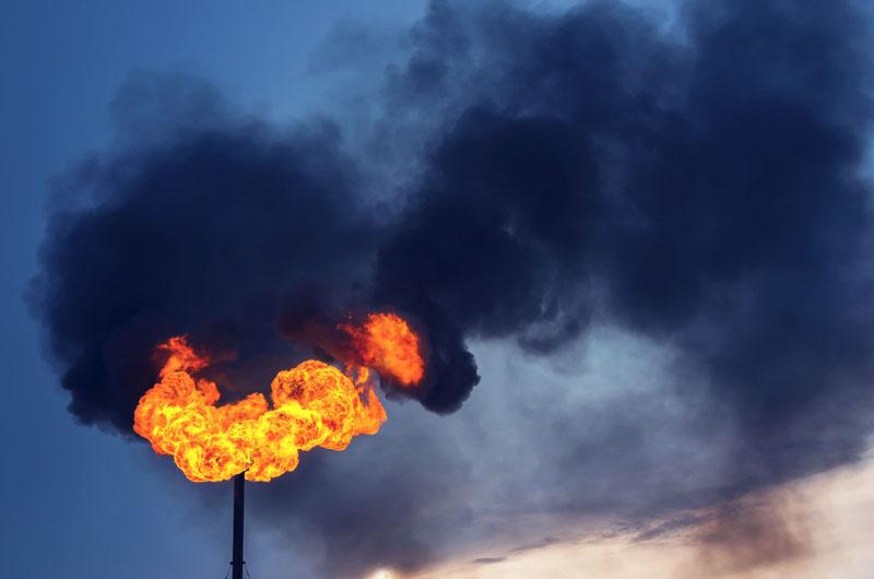 Methane flare, black smoke. Photo credit: Leonid Ikan / Shutterstock
