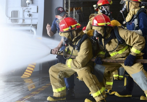 Firefighters using PFAS fire fighting foam