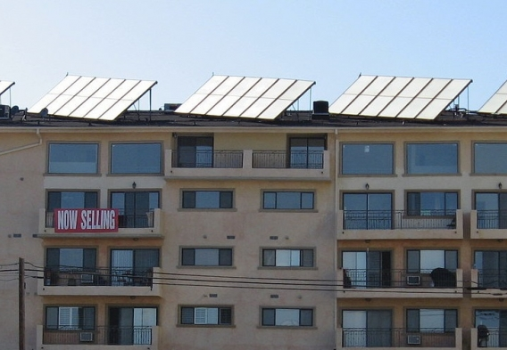 Shared solar panels on top of a multifamily apartment building.