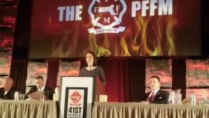 Elizabeth Saunders speaks at Professional Fire Fighters  of Massachusetts annual meeting.